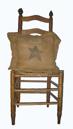 Old Chair displaying Pillow